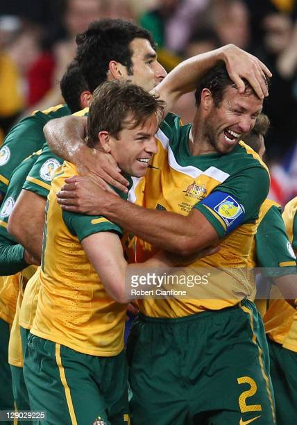 Brett Homan of Australia celebrates his goal with Lucas Neill during the FIFA World Cup Asian Qualifier match between the Australian Socceroos and...