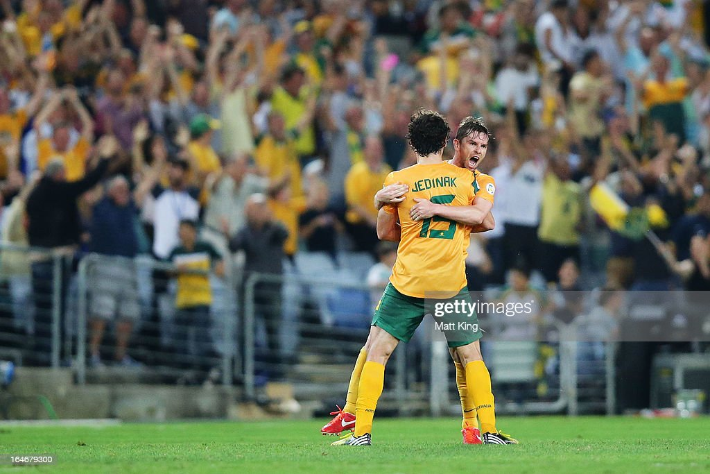 Brett Homan (R) of the Socceroos celebrates with <a gi-track='captionPersonalityLinkClicked' href=/galleries/search?phrase=Mile+Jedinak&family=editorial&specificpeople=3123629 ng-click='$event.stopPropagation()'>Mile Jedinak</a> (L) after scoring a goal during the FIFA 2014 World Cup Qualifier match between the Australian Socceroos and Oman at ANZ Stadium on March 26, 2013 in Sydney, Australia.