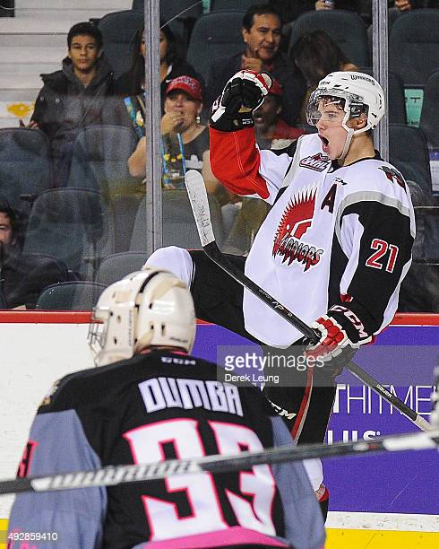 Brett Howden of the Moose Jaw Warriors scores on Kyle Dumba of the Calgary Hitmen during a WHL game at Scotiabank Saddledome on October 15 2015 in...