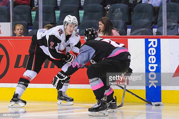 Brett Howden of the Moose Jaw Warriors skates with the puck against Jake Bean of the Calgary Hitmen during a WHL game at Scotiabank Saddledome on...