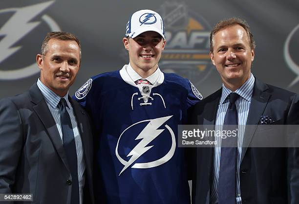 Brett Howden poses with Steve Yzerman and head coach John Cooper after being selected 27th overall by the Tampa Bay Lightning during round one of the...