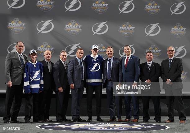 Brett Howden poses with team personnel after being selected 27th overall by the Tampa Bay Lightning during round one of the 2016 NHL Draft at First...