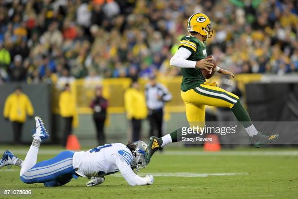 Brett Hundley of the Green Bay Packers avoids a tackle attempt by Ezekiel Ansah of the Detroit Lions in the third quarter at Lambeau Field on...