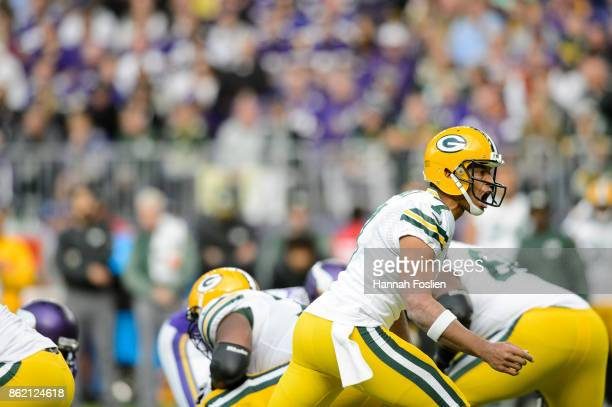 Brett Hundley of the Green Bay Packers calls a play at the line of scrimmage against the Minnesota Vikings during the game on October 15 2017 at US...