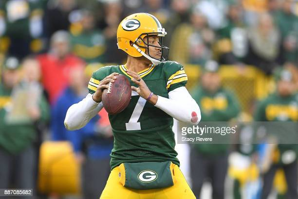 Brett Hundley of the Green Bay Packers drops back to pass during a game against the Tampa Bay Buccaneers at Lambeau Field on December 3 2017 in Green...