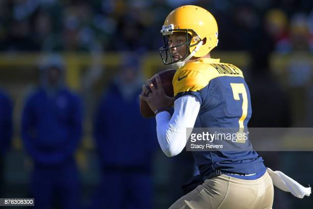 Brett Hundley of the Green Bay Packers drops back to pass during the first half against the Baltimore Ravens at Lambeau Field on November 19 2017 in...