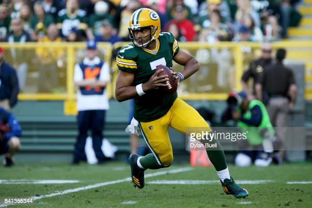 Brett Hundley of the Green Bay Packers drops back to pass in the first quarter against the Los Angeles Rams during a preseason game at Lambeau Field...