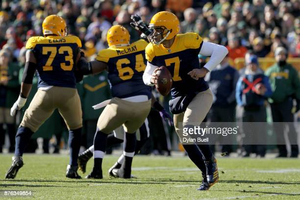 Brett Hundley of the Green Bay Packers drops back to pass in the first quarter against the Baltimore Ravens at Lambeau Field on November 19 2017 in...