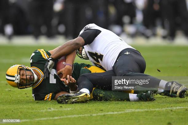 Brett Hundley of the Green Bay Packers is brought down by Cameron Jordan of the New Orleans Saints during the second quarter at Lambeau Field on...