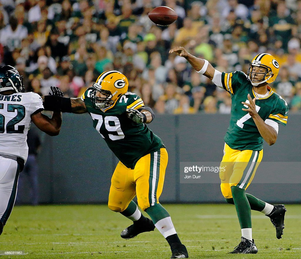 Brett Hundley #7 of the Green Bay Packers passes the ball as Josh Walker #79 blocks Brad Jones #52 of the Philadelphia Eagles during a preseason game at Lambeau Field on August 29, 2015 in Green Bay, Wisconsin.