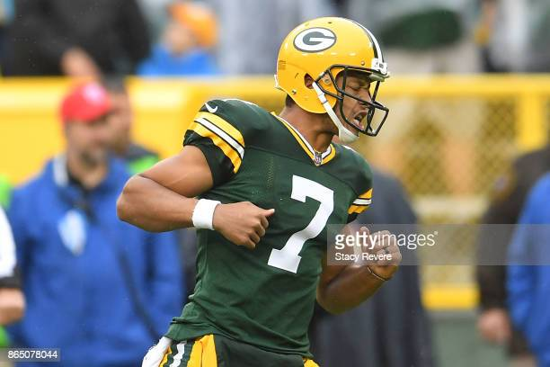 Brett Hundley of the Green Bay Packers reacts to a touchdown against the New Orleans Saints during the first quarter at Lambeau Field on October 22...