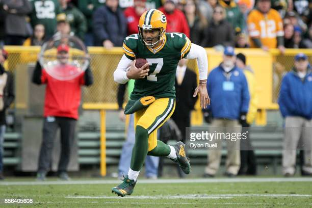 Brett Hundley of the Green Bay Packers runs with the ball in overtime against the Tampa Bay Buccaneers at Lambeau Field on December 3 2017 in Green...