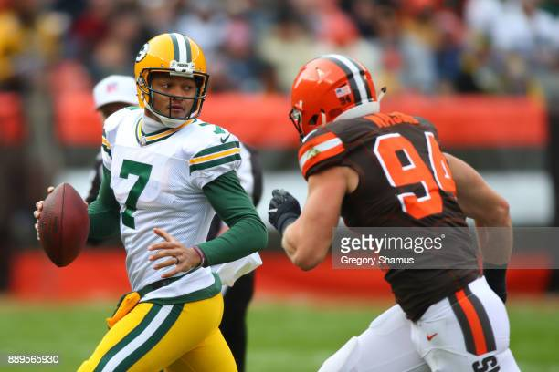 Brett Hundley of the Green Bay Packers scrambles out of the pocket pursued by Carl Nassib of the Cleveland Browns in the first quarter at FirstEnergy...