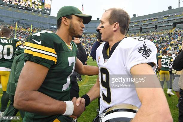 Brett Hundley of the Green Bay Packers speaks with Drew Brees of the New Orleans Saints at midfield following a game at Lambeau Field on October 22...