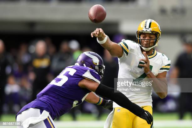 Brett Hundley of the Green Bay Packers throws the ball before being hit by Anthony Barr of the Minnesota Vikings during the second quarter of the...