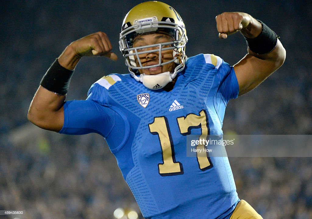 <a gi-track='captionPersonalityLinkClicked' href=/galleries/search?phrase=Brett+Hundley&family=editorial&specificpeople=8674236 ng-click='$event.stopPropagation()'>Brett Hundley</a> #17 of the UCLA Bruins celebrates his run for a touchdown for a 38-14 lead over the USC Trojans during the third quarter at the Rose Bowl on November 22, 2014 in Pasadena, California. UCLA won 38-14.