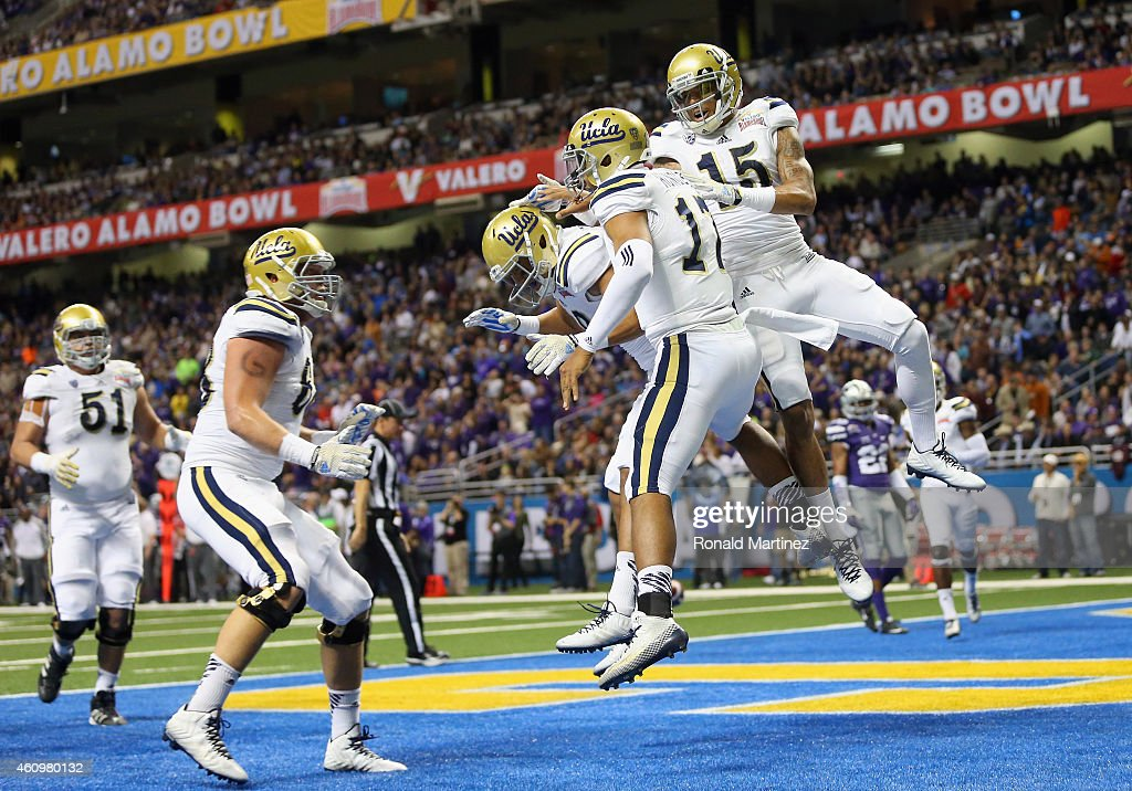 <a gi-track='captionPersonalityLinkClicked' href=/galleries/search?phrase=Brett+Hundley&family=editorial&specificpeople=8674236 ng-click='$event.stopPropagation()'>Brett Hundley</a> #17 of the UCLA Bruins celebrates his touchdown against the Kansas State Wildcats in the first quarter during the Valero Alamo Bowl at Alamodome on January 2, 2015 in San Antonio, Texas.