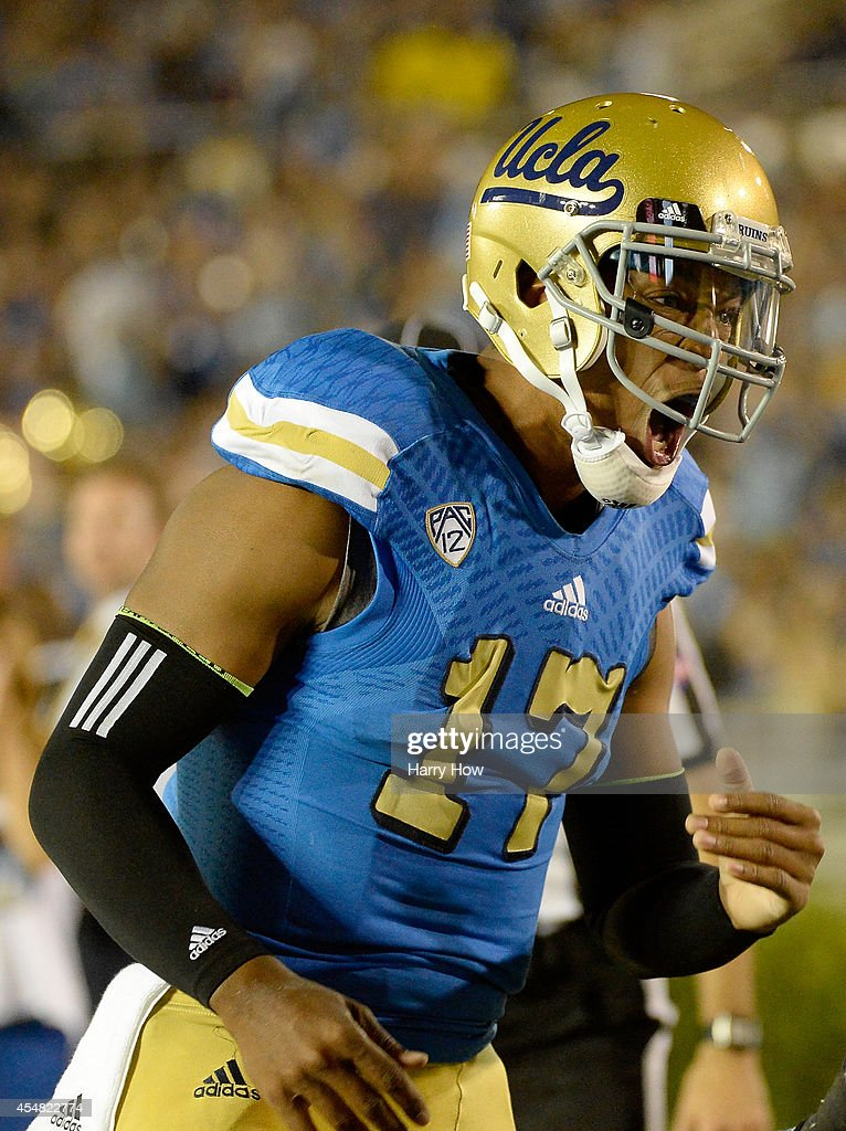 <a gi-track='captionPersonalityLinkClicked' href=/galleries/search?phrase=Brett+Hundley&family=editorial&specificpeople=8674236 ng-click='$event.stopPropagation()'>Brett Hundley</a> #17 of the UCLA Bruins reacts to his touchdwon pass to Thomas Duarte #18 during the first half at Rose Bowl on September 6, 2014 in Pasadena, California.