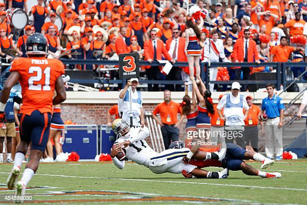 Brett Hundley of the UCLA Bruins rushes for a sixyard touchdown in the third quarter of the game against the Virginia Cavaliers at Scott Stadium on...