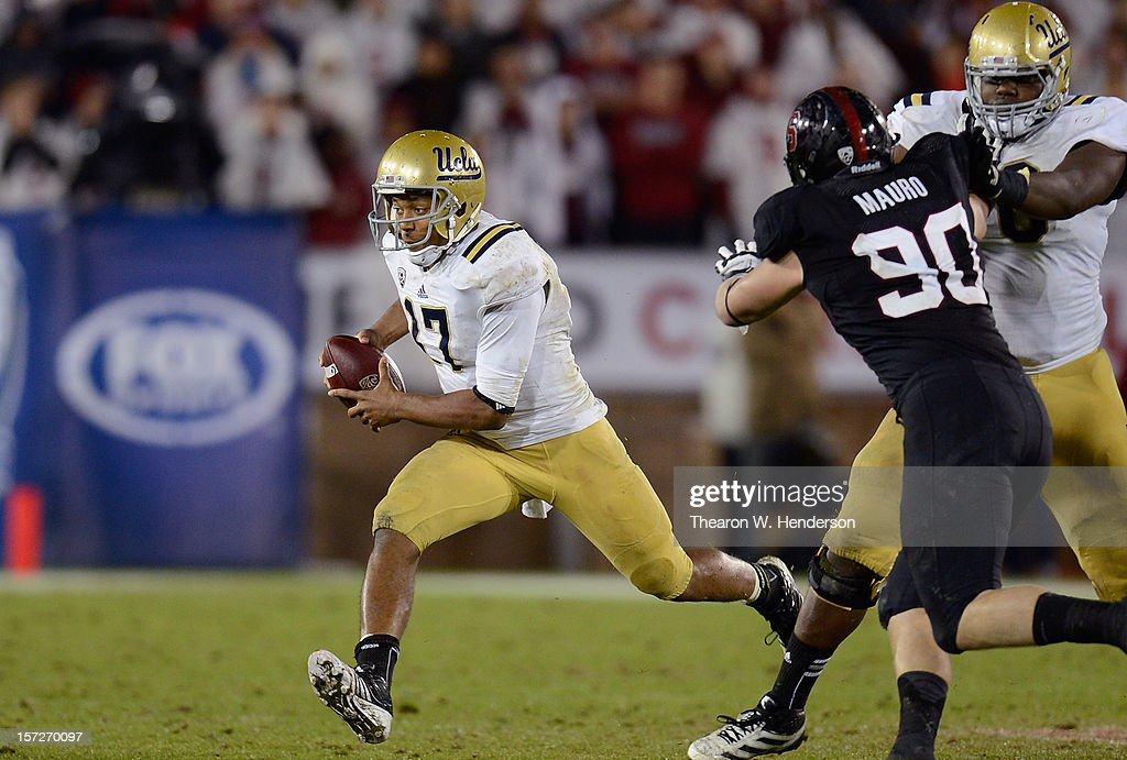 Brett Hundley #17 of the UCLA Bruins scrambles for a five yard gain and a first down against the Stanford Cardinal in the third quarter during the Pac-12 Championship Game at Stanford Stadium on November 30, 2012 in Stanford, California. Stanford won the game 27-24.