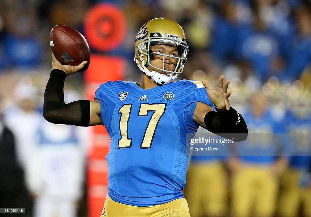 <a gi-track='captionPersonalityLinkClicked' href=/galleries/search?phrase=Brett+Hundley&family=editorial&specificpeople=8674236 ng-click='$event.stopPropagation()'>Brett Hundley</a> #17 of the UCLA Bruins throws a pass against the California Golden Bears at the Rose Bowl on October 12, 2013 in Pasadena, California. UCLA won 37-10.