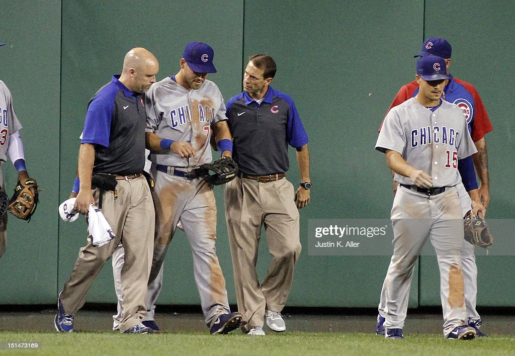 Brett Jackson #7 of the Chicago Cubs is helped off the field by medical staff after running into the wall in the sixth inning against the Pittsburgh Pirates during the game on September 7, 2012 at PNC Park in Pittsburgh, Pennsylvania.