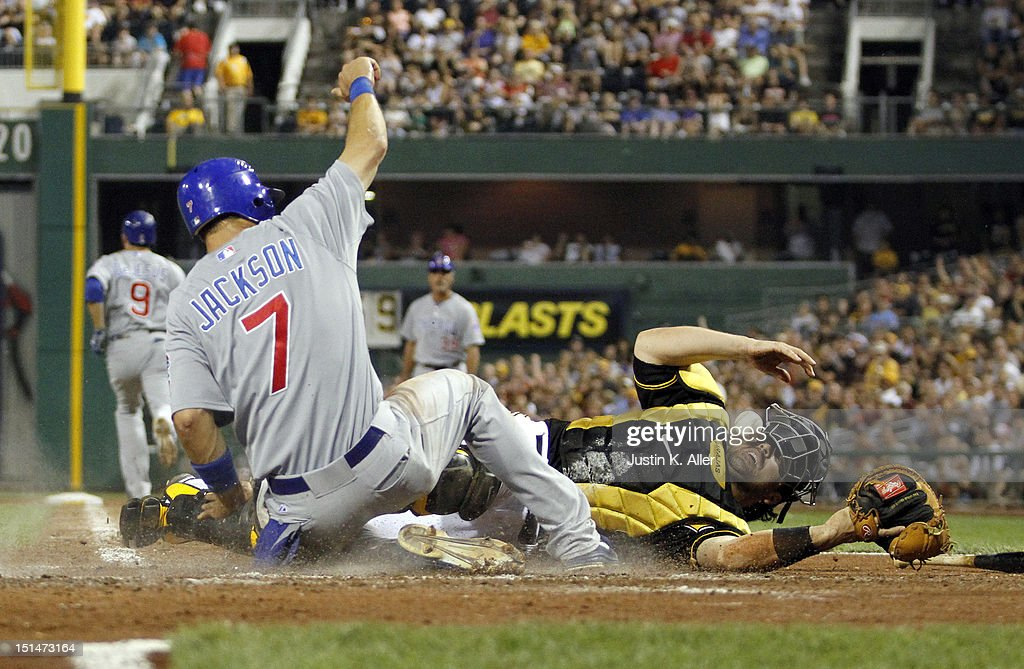 Brett Jackson #7 of the Chicago Cubs scores on a throwing error against catcher <a gi-track='captionPersonalityLinkClicked' href=/galleries/search?phrase=Rod+Barajas&family=editorial&specificpeople=211198 ng-click='$event.stopPropagation()'>Rod Barajas</a> #26 of the Pittsburgh Pirates in the sixth inning during the game on September 7, 2012 at PNC Park in Pittsburgh, Pennsylvania.