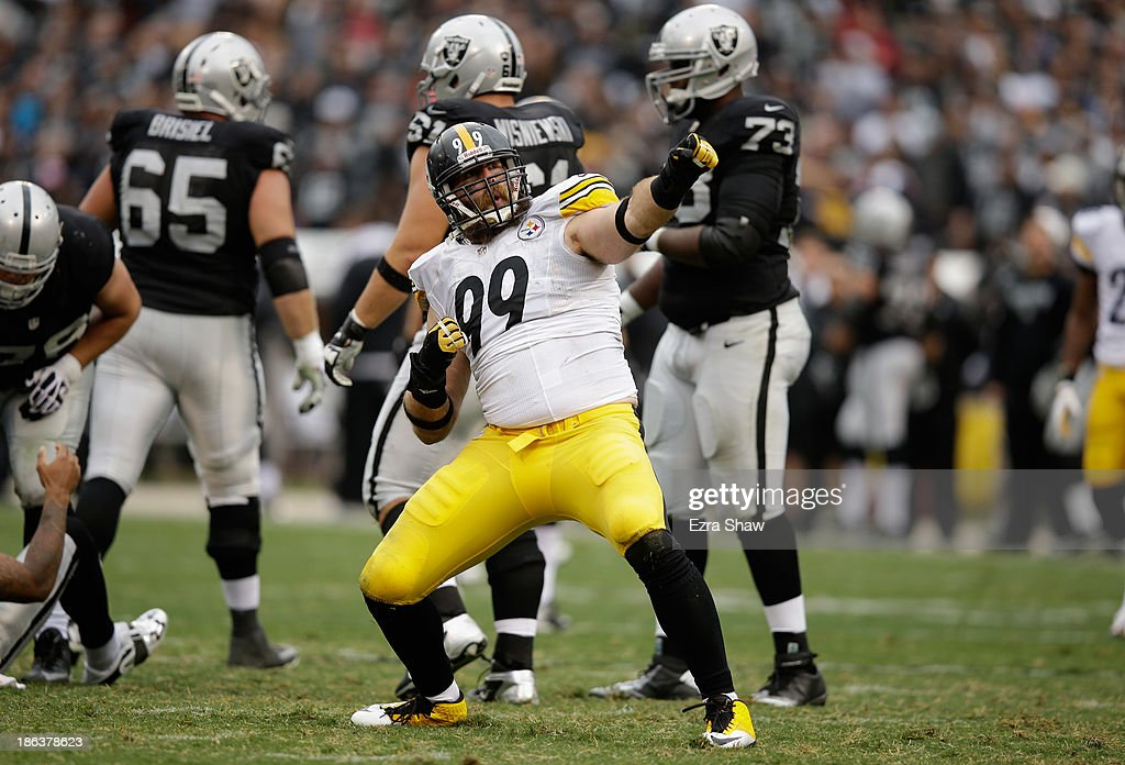 <a gi-track='captionPersonalityLinkClicked' href=/galleries/search?phrase=Brett+Keisel&family=editorial&specificpeople=748671 ng-click='$event.stopPropagation()'>Brett Keisel</a> #99 of the Pittsburgh Steelers reacts after making a tackle against the Oakland Raiders at O.co Coliseum on October 27, 2013 in Oakland, California.