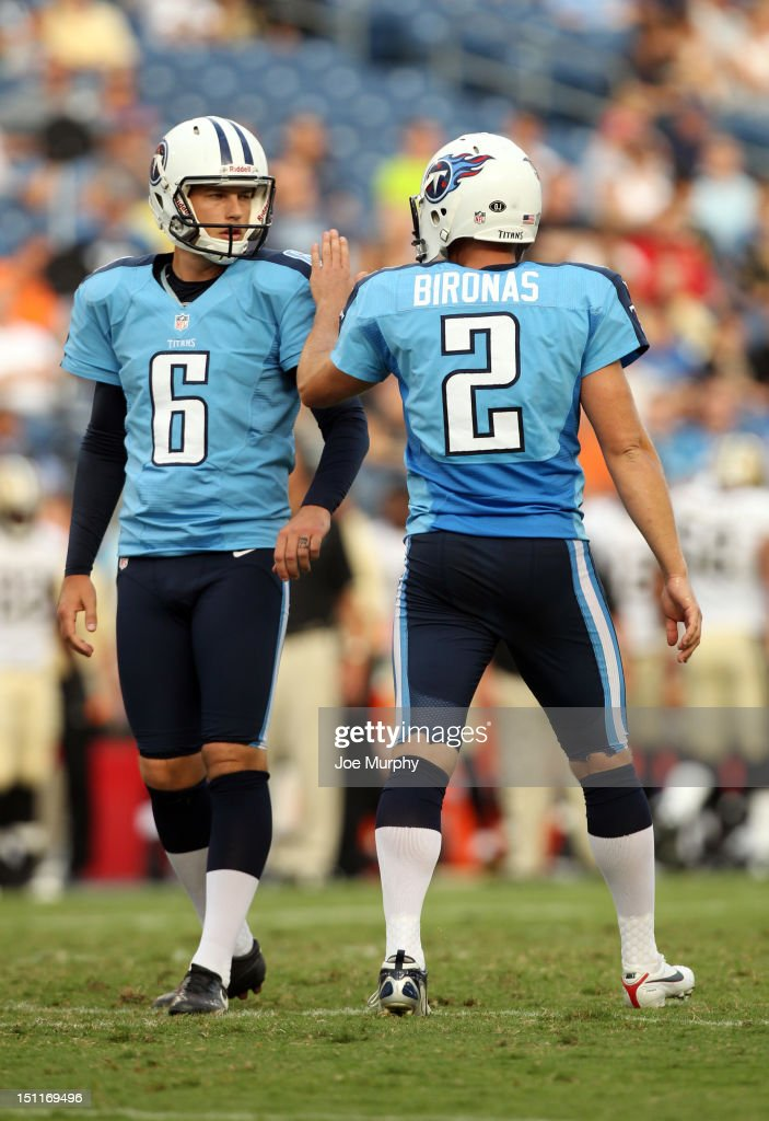 Brett Kern #6 and Rob Bironas #2 of the Tennessee Titans celebrate after a made field goal against the New Orleans Saints at LP Field on August 30, 2012 in Nashville, Tennessee.