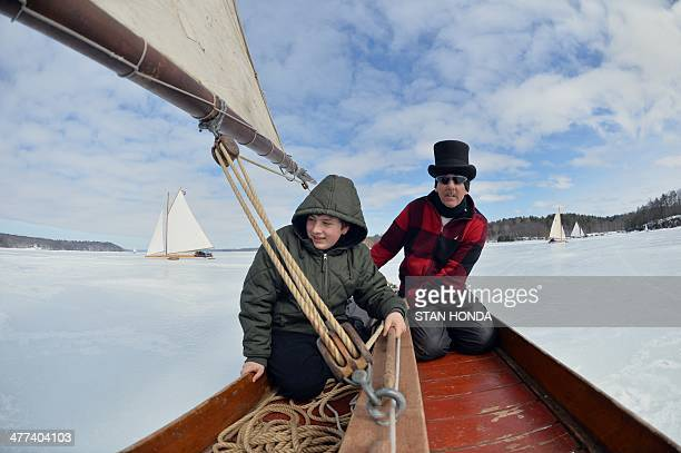 Brett Kolfrat sails his ice boat Genevieve with Warren Batycki on a frozen Hudson River March 7 2014 in Barrytown New York These historic 'ice...