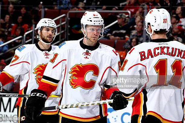 Brett Kulak Michael Frolik and Mikael Backlund of the Calgary Flames wait for a faceoff during the game against the Anaheim Ducks on November 6 2016...