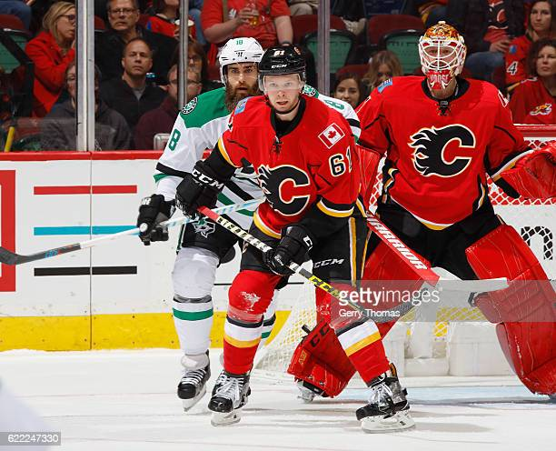 Brett Kulak of the Calgary Flames battles against Patrick Eaves of the Dallas Stars at Scotiabank Saddledome on November 10 2016 in Calgary Alberta...