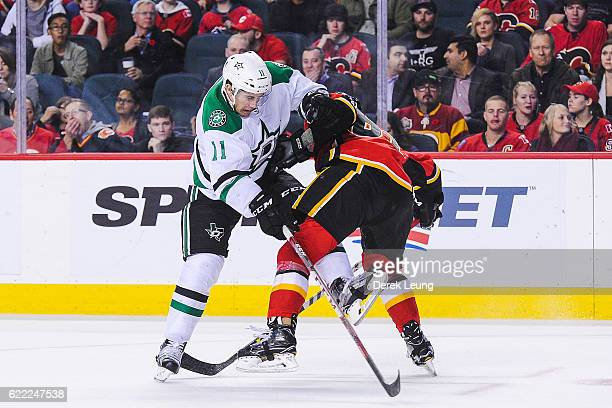 Brett Kulak of the Calgary Flames collides with Curtis McKenzie of the Dallas Stars during an NHL game at Scotiabank Saddledome on November 10 2016...