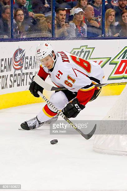 Brett Kulak of the Calgary Flames controls the puck during the game against the Columbus Blue Jackets on November 23 2016 at Nationwide Arena in...