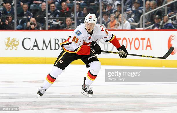 Brett Kulak of the Calgary Flames follows the play down the ice during second period action at the MTS Centre on October 16 2015 in Winnipeg Manitoba...