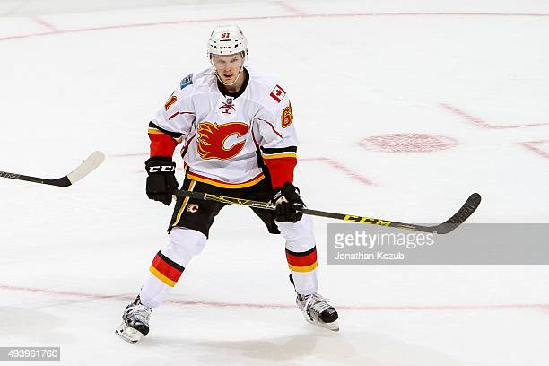 Brett Kulak of the Calgary Flames keeps an eye on the play during second period action against the Winnipeg Jets at the MTS Centre on October 16 2015...
