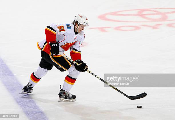 Brett Kulak of the Calgary Flames plays the puck during third period action against the Winnipeg Jets on April 11 2015 at the MTS Centre in Winnipeg...