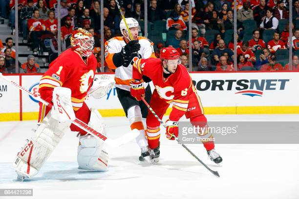 Brett Kulak of the Calgary Flames skates against the Philadelphia Flyers during an NHL game on February 15 2017 at the Scotiabank Saddledome in...