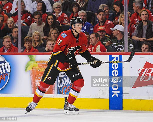Brett Kulak of the Calgary Flames skates against the Vancouver Canucks in the season opener at Scotiabank Saddledome on October 7 2015 in Calgary...
