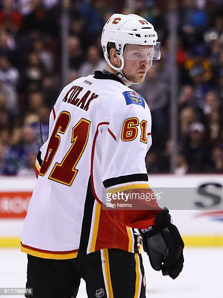 Brett Kulak of the Calgary Flames skates against the Vancouver Canucks during their NHL game at Rogers Arena on October 15 2016 in Vancouver British...
