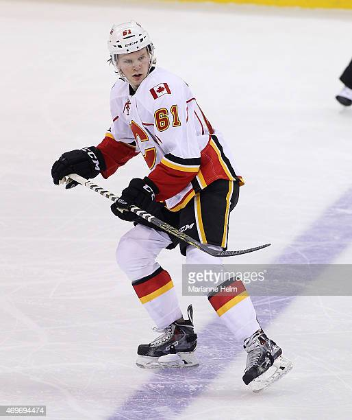 Brett Kulak of the Calgary Flames skates down the ice during first period action in an NHL game against the Winnipeg Jets at the MTS Centre on April...