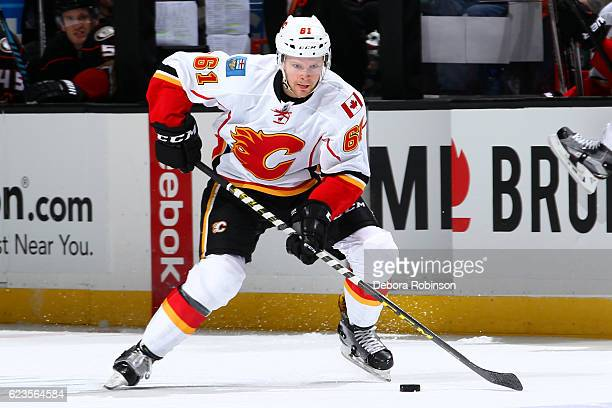 Brett Kulak of the Calgary Flames skates with the puck during the game against the Anaheim Ducks on November 6 2016 at Honda Center in Anaheim...