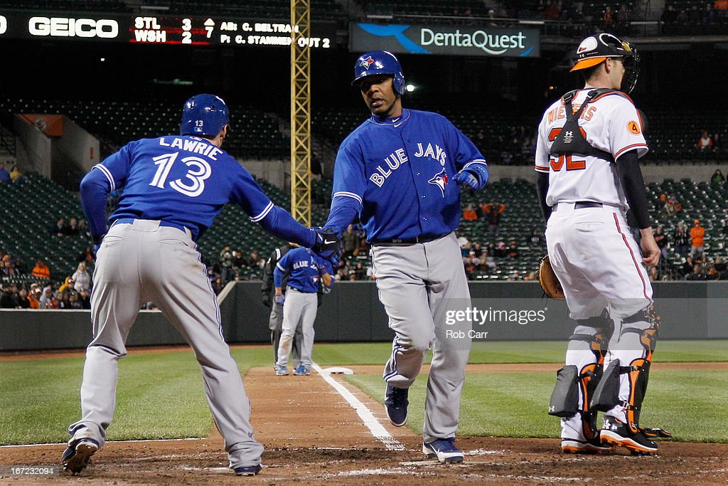 <a gi-track='captionPersonalityLinkClicked' href=/galleries/search?phrase=Brett+Lawrie&family=editorial&specificpeople=5496694 ng-click='$event.stopPropagation()'>Brett Lawrie</a> #13 congratulates Edwin Encarnacion #10 of the Toronto Blue Jays after he scored a run in front of catcher Matt Wieters #32 of the Baltimore Orioles during the seventh inning at Oriole Park at Camden Yards on April 22, 2013 in Baltimore, Maryland. The Orioles won 2-1.