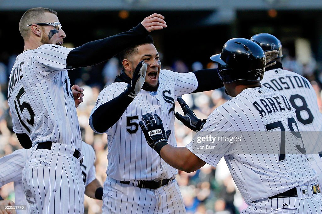 <a gi-track='captionPersonalityLinkClicked' href=/galleries/search?phrase=Brett+Lawrie&family=editorial&specificpeople=5496694 ng-click='$event.stopPropagation()'>Brett Lawrie</a> #15 of the Chicago White Sox (L) and <a gi-track='captionPersonalityLinkClicked' href=/galleries/search?phrase=Melky+Cabrera&family=editorial&specificpeople=453444 ng-click='$event.stopPropagation()'>Melky Cabrera</a> #53 (C) celebrate with Jose Abreu #79 (R) after he hit a walkoff RBI single against the Texas Rangers during the eleventh inning at U.S. Cellular Field on April 23, 2016 in Chicago, Illinois. The Chicago White Sox won 4-3 in eleven innings.
