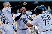 Brett Lawrie of the Chicago White Sox and Melky Cabrera celebrate with Jose Abreu after he hit a walkoff RBI single against the Texas Rangers during...