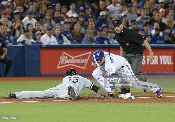 Brett Lawrie of the Chicago White Sox gets back safely to third base in the fifth inning during MLB game action as Troy Tulowitzki of the Toronto...