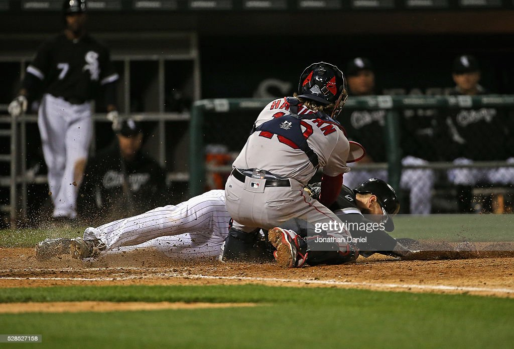 <a gi-track='captionPersonalityLinkClicked' href=/galleries/search?phrase=Brett+Lawrie&family=editorial&specificpeople=5496694 ng-click='$event.stopPropagation()'>Brett Lawrie</a> #15 of the Chicago White Sox is tagged out at the plate by <a gi-track='captionPersonalityLinkClicked' href=/galleries/search?phrase=Ryan+Hanigan&family=editorial&specificpeople=833982 ng-click='$event.stopPropagation()'>Ryan Hanigan</a> #10 of the Boston Red Sox to end the 5th inning at U.S. Cellular Field on May 5, 2016 in Chicago, Illinois.