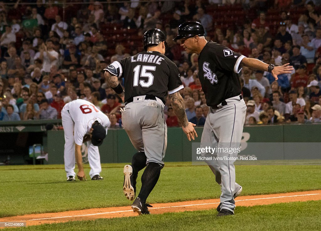 Brett Lawrie #15 of the Chicago White Sox slaps hands with third base coach Joe McEwing #47 after hitting a home run against Koji Uehara #19 of the Boston Red Sox in the eighth inning on June 22, 2016 at Fenway Park in Boston, Massachusetts.