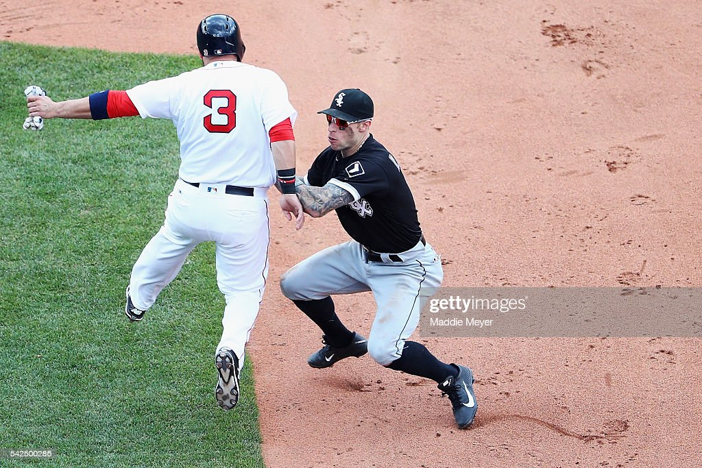 Brett Lawrie #15 of the Chicago White Sox tags out Sandy Leon #3 of the Boston Red Sox during the sixth inning at Fenway Park on June 23, 2016 in Boston, Massachusetts.