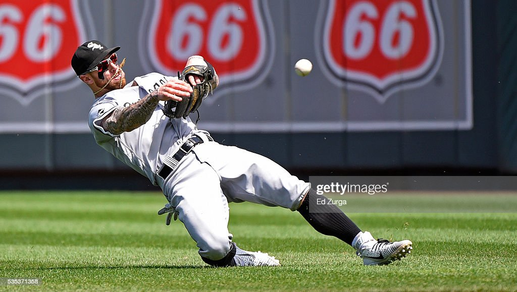 <a gi-track='captionPersonalityLinkClicked' href=/galleries/search?phrase=Brett+Lawrie&family=editorial&specificpeople=5496694 ng-click='$event.stopPropagation()'>Brett Lawrie</a> #15 of the Chicago White Sox throws to first as he tries to get the out on Alcides Escobar #2 of the Kansas City Royals in the fifth inning at Kauffman Stadium on May 29, 2016 in Kansas City, Missouri. Escobar was safe on the play.